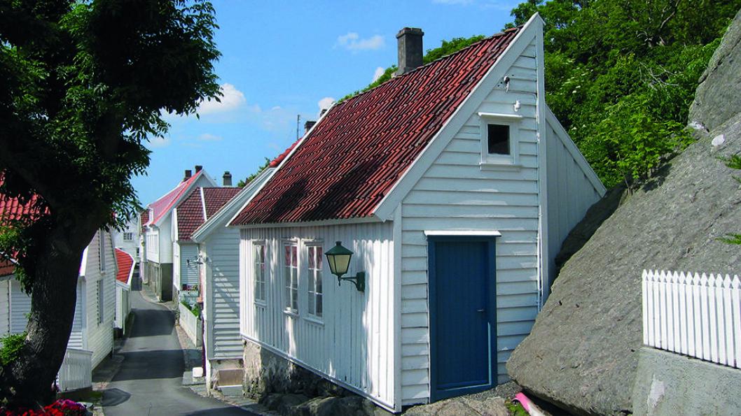 SEILSKUTEBYEN: Sjarmerende Skudeneshavn ligger ytterst på sørspissen av Karmøy. 130 hus og naust er bevart fra den gangen sildefisket tidlig på 1800-tallet skapte hektisk virksomhet i byen. Foto: Ørjan B. Iversen